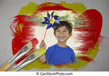 Composite image of little boy with pinwheel with paintbrush...