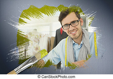 Composite image of fashion designer smiling at camera with...