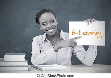 Happy teacher holding page showing e learning in her...