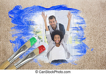 Composite image of colleagues having fun with paintbrush...
