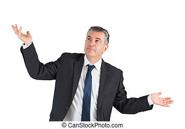 Mature businessman standing with arms out on white...