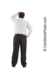 Mature businessman standing scratching head on white...