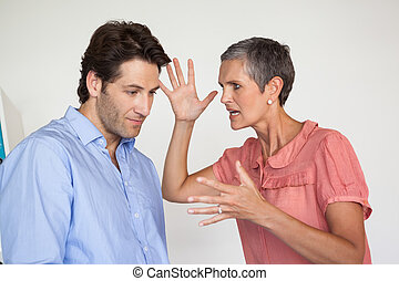 Angry businesswoman shouting at employee