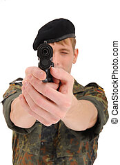soldier aiming with gun at camera - soldier aiming with gun...