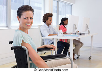 Woman in wheelchair working hard in the office