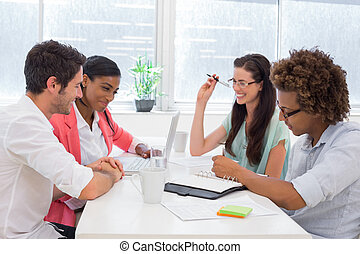 Casual workers communicating and planning in the office