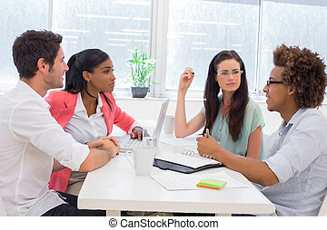 Business people having a meeting together in the office