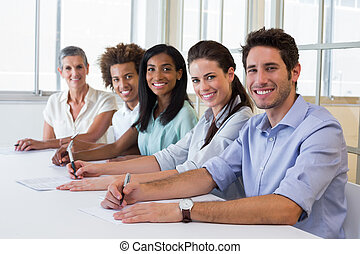 Group of workers looking at camera in the office