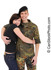 happy couple, a soldier and his girlfriend hugging and...