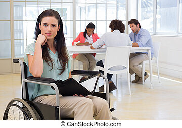 Attractive disabled businesswoman at work smiling at the...