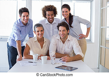 Attractive business people smiling in the workplace -...