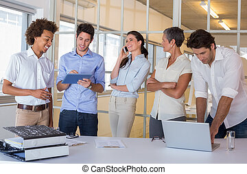 Attractive business people working together - Attractive...