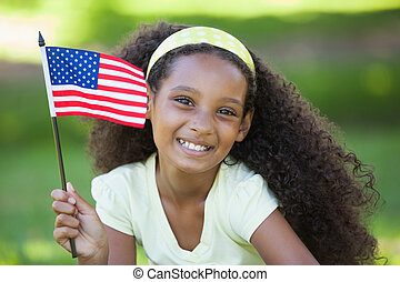 Young girl celebrating independence day in the park on a...