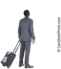 Businessman standing with his suitcase