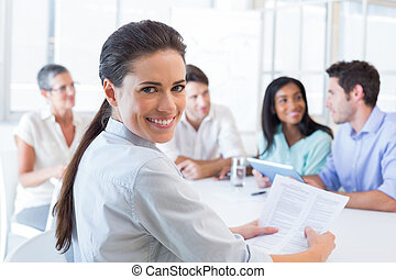 Attractive businesswoman smiling in the workplace -...
