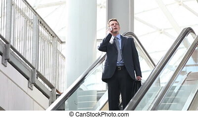 business man on escalator