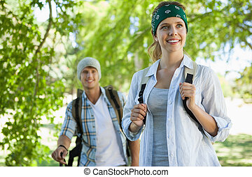 Happy active couple going on a hike
