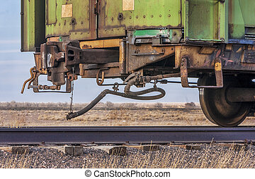 end of train on a sidetrack - a rail car for livestock...