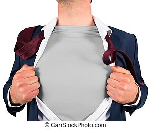 Businessman opening shirt in superhero style on white...