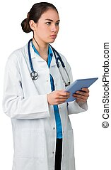 Young doctor standing with tablet pc