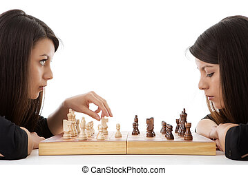 next move - young woman playing chess against herself shot...