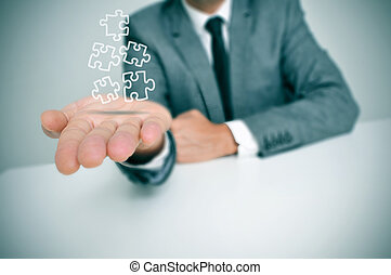 businessman with jigsaw puzzle pieces - a businessman with...