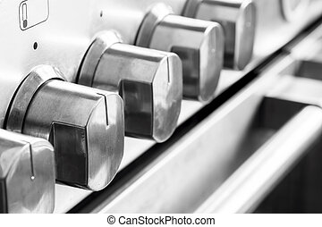 Close up image of stainless steel cooker knobs
