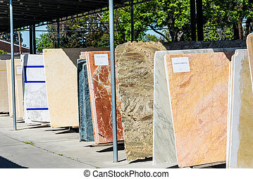 Colorful granite and marble slabs for sale in store yard
