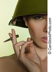 Woman with a cartridge in helmet - Woman with a cartridge in...