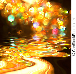 multi-coloured stains reflected in wavy water - Abstract...