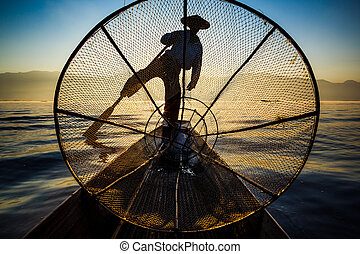 Silhouette fishermen in Inle Lake at sunrise, Inle, Shan...