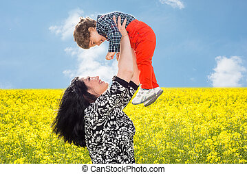 Mom raise uop her son in canola field - Mother raise up her...
