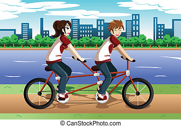 Young couple riding a tandem bike