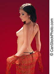 naked brunette on the red background - beautiful naked...