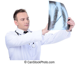 Medicine - Young doctor looking to x-ray , isolated on white