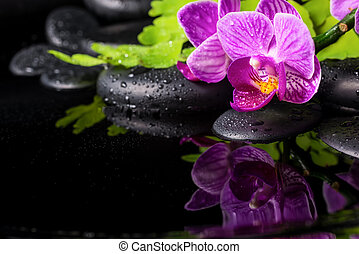 Beautiful spa setting of stripped lilac orchid...