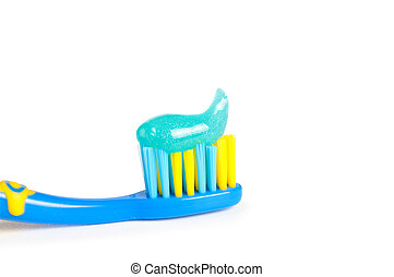 colorful toothbrushes in a water glass with