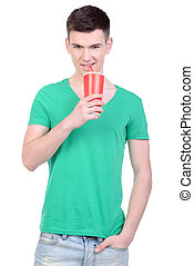 Fast Food - Young man eating fast food isolated on white...