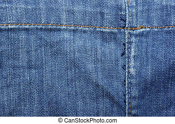 Blue jeans with yellow thread. Use as backdrop, background.