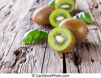 Fresh fruits - Fresh kiwi fruits on wooden table Wood...