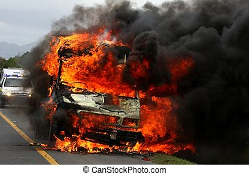Burning Van with Police car in Background - Vehicle ablaze...