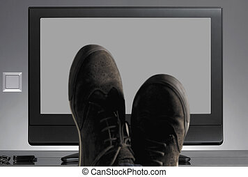 TV and shoes out of focus with neutral background....