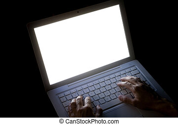Typing on Laptop - hands typing a letter in the keyboard of...