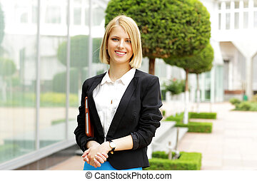 Young happy fashion woman standing outdoors