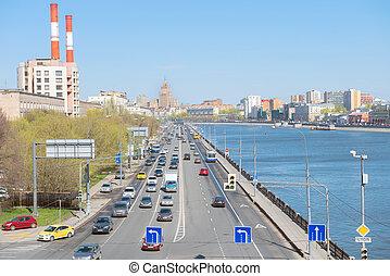 Traffic flow freely on Berezhkovskaya Embankment of Moscow...