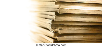 Stack of old magazines as background