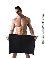 Naked young male bodybuilder holding blank board - Naked...