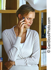 mid adult woman with her mobile phone at home