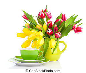 yellow tulips flowers with cup tea, on a white background...
