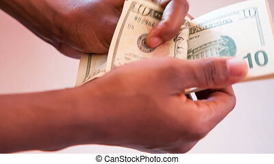 hand counting dollar bills - Close up of a african american...